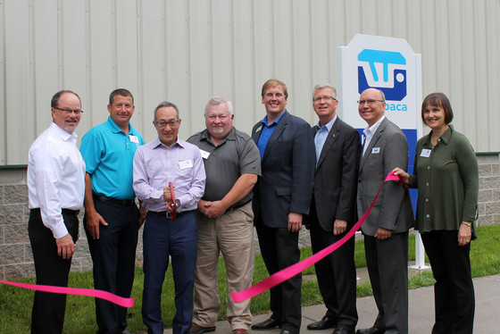 Akitoshi Hiraki cuts the ceremonial ribbon | From left to right: Waupaca Foundry EVP, John Wiesbrock; Waupaca Foundry President, COO & CEO Michael Nikolai; Vice Chairmen of Hitachi Metals Ltd, Akitoshi Hiraki; Rep. Greg Markkanen – State Representative 110th District; Sen. Ed McBroom – State Senator 38th District; MEDC CEO Jeff Mason; MEDC Business Development Project Manager David Kurtycz; City of Ironwood Mayor Annette Burchell