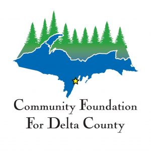 The Delta County Community Foundation logo. It features a blue Upper Peninsula, and on the northern coast is an image of green trees.