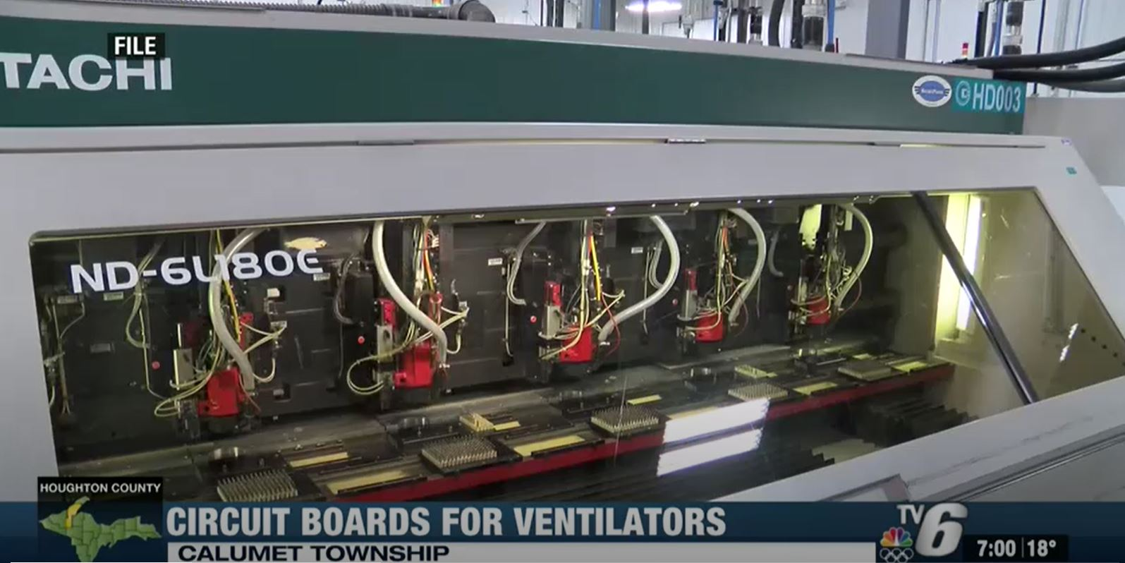 """A screenshot of a machine in the Calumet Electronics facility with the tagline that says, """"Circuit boards for ventilators."""""""