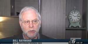 Bill Raymond, in a close-up shot, being interviewed by TV 6.
