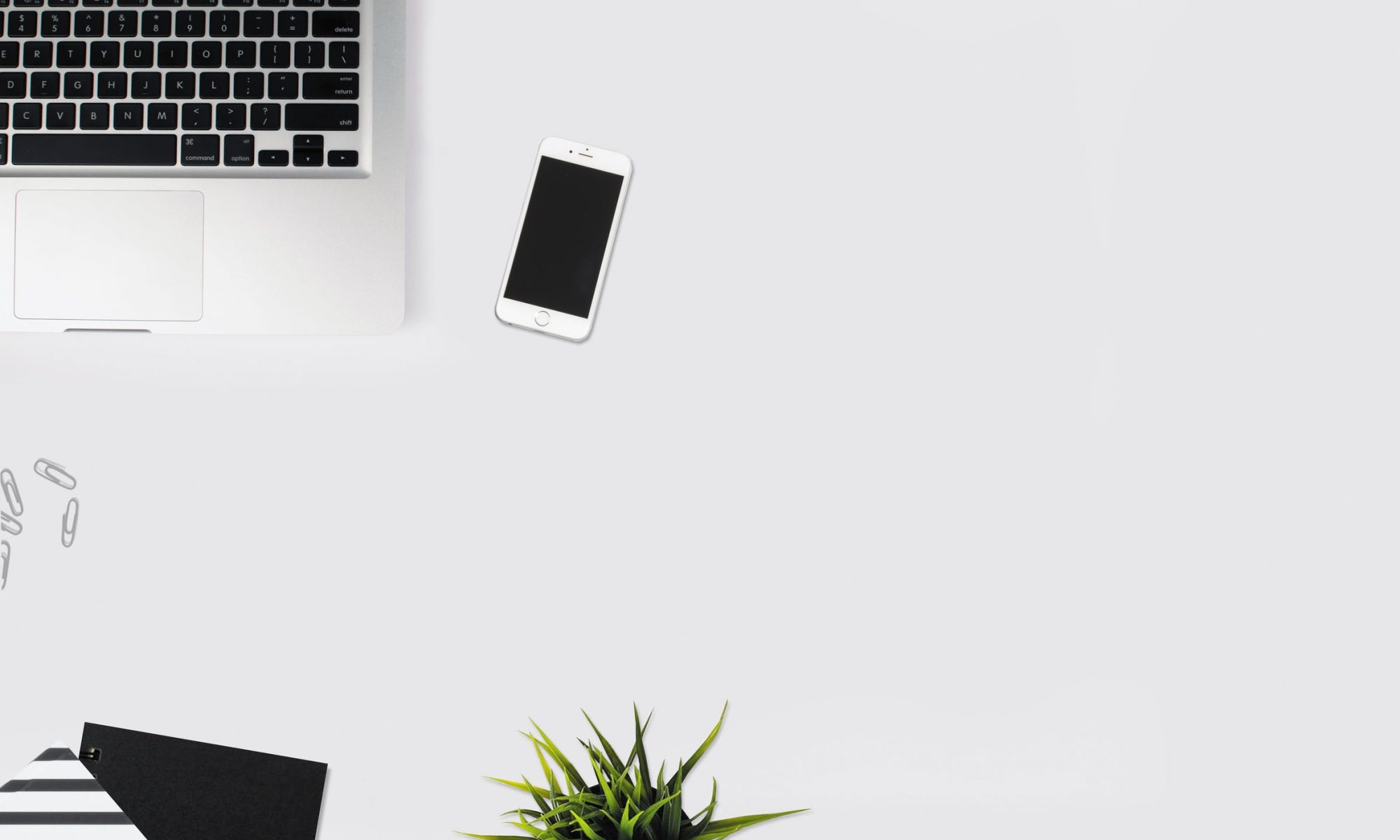 A stock image of laptops and a white iPhone.