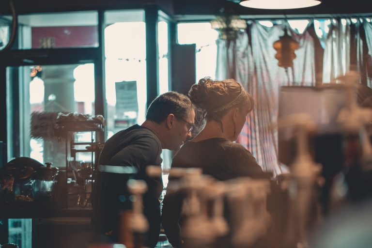 A stock image of a man and woman in a shop working.