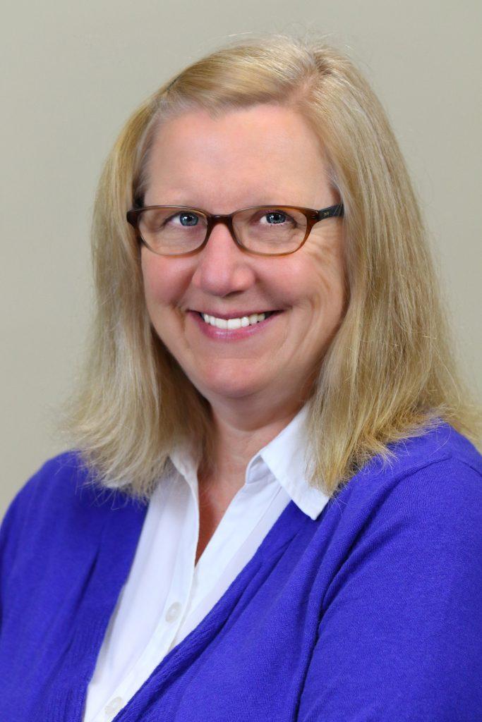 A headshot of Karen Dugdale, WSM.