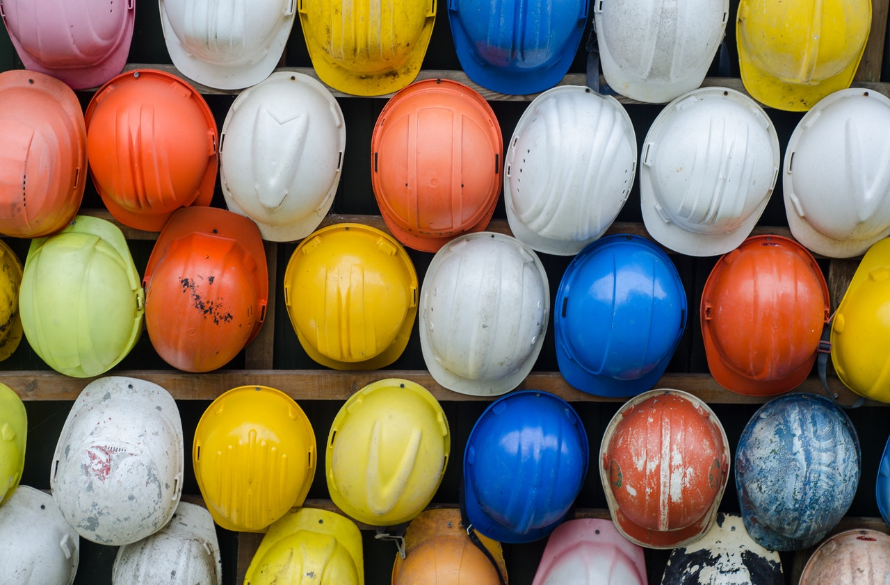 Hard hats hanging on a wall.