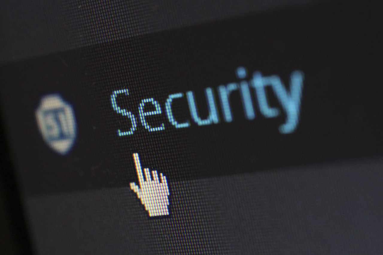 """A mouse hovers over text on a computer that says, """"Security."""""""