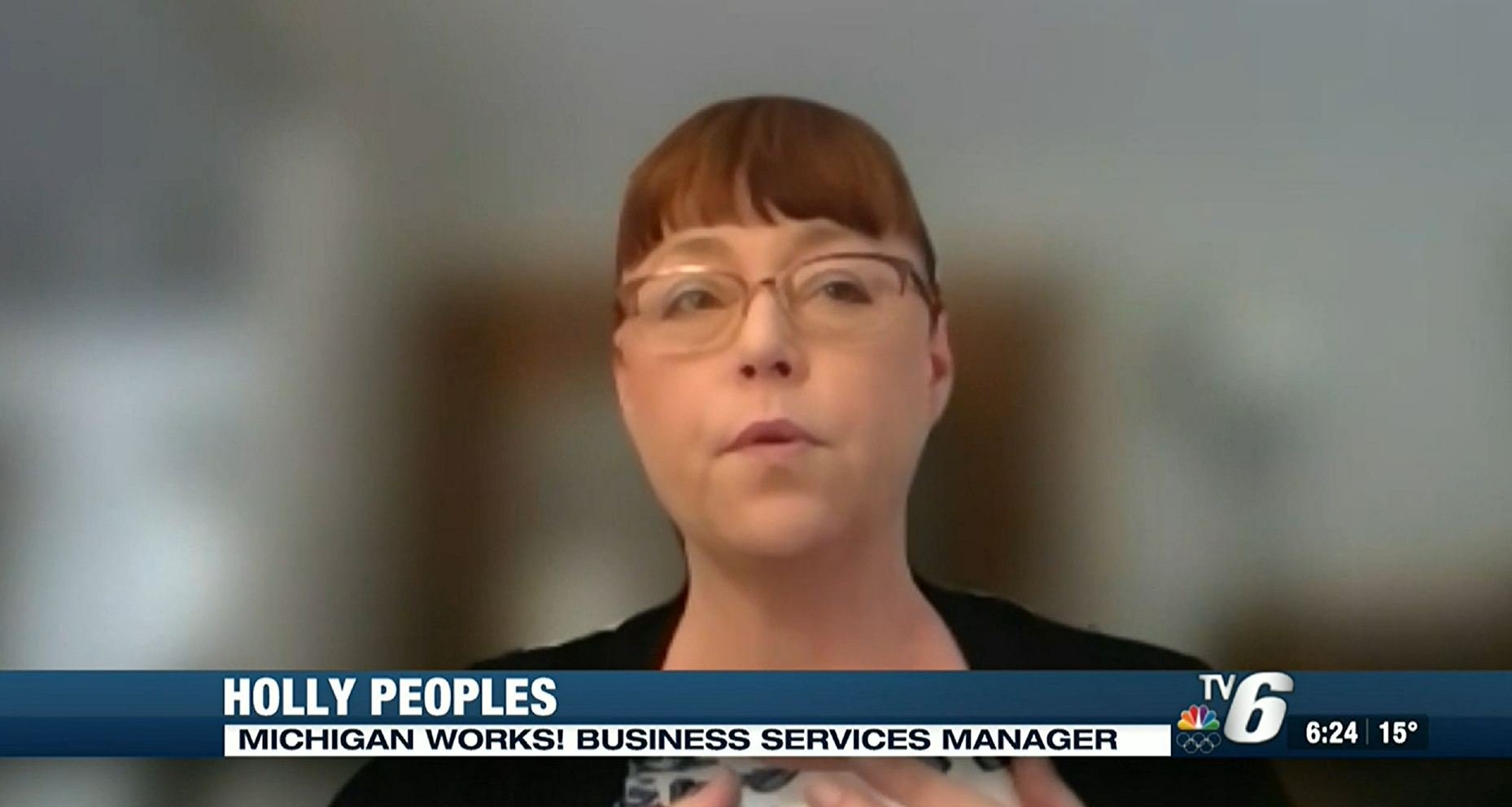 Screen capture of Holly Peoples being interviewed on TV 6.