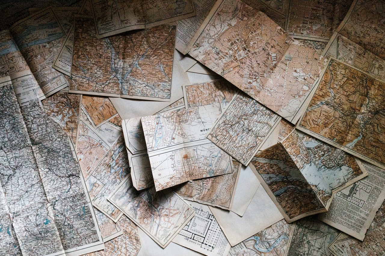 Maps overlapping each other on a surface.